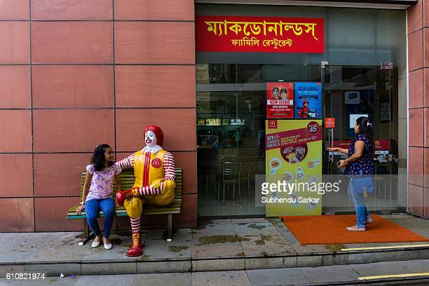 A young girl enjoys herself at a McDonald's food restaurant at a big shopping center