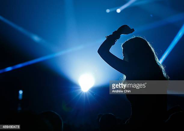 A young girl enjoys Skrillex' performance at 2013 Contact Winter Music Festival on December 26 2013 in Vancouver Canada