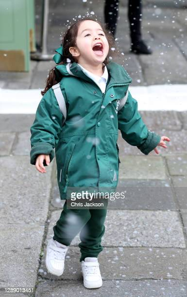 Young girl enjoys the artificial snow-fall as Covent Garden welcomes back shoppers and diners after UK lockdown at Covent Garden on December 02, 2020...