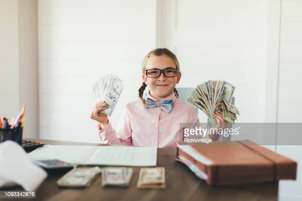 young girl entrepreneur at work - adult imitation stock pictures, royalty-free photos & images