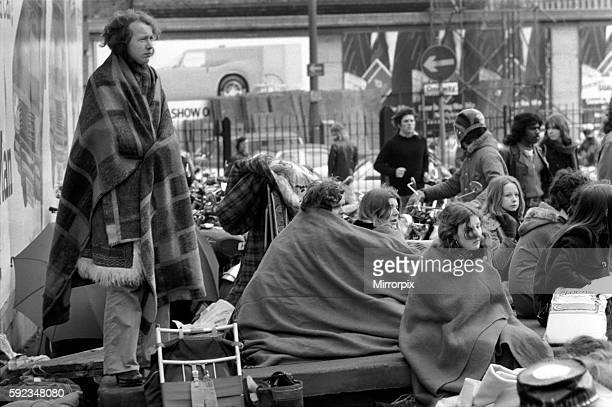 Young girl fans wrap themselves up in blankets after their all night vigil for tickets. March 1975 75-01455-006