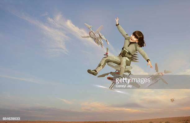 young girl flying on futuristic chair - coneyl stock pictures, royalty-free photos & images
