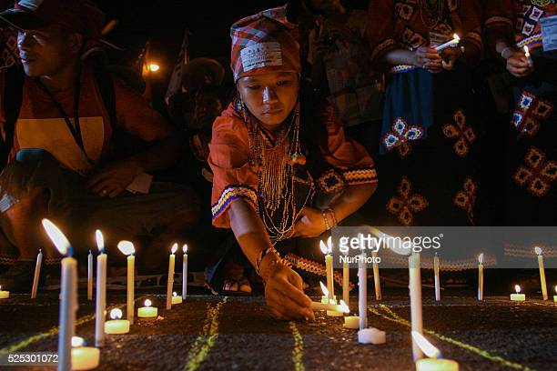 A young girl from a local tribe in Mindanao light up candles in front of the Redemptorist church in Baclaran Paranaque Hundreds of delegates from...