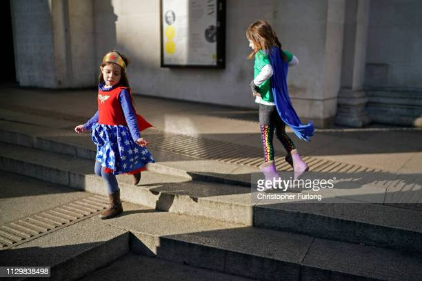A young girl from a nursery school dresses as a super hero to save the planet as she joins other schoolchildren and students taking part in a student...