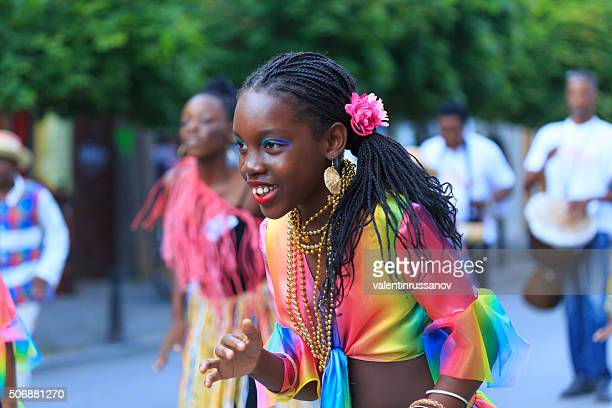 Young girl from folklore group Martinique performing at festival's parade
