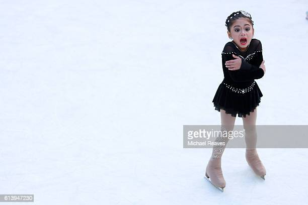 A young girl from Ice Theatre of New York shivers from the cold at The Rink at Rockefeller Center on October 11 2016 in New York City The iconic ice...