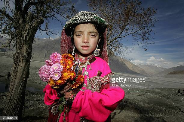 Young girl from Nansoq Organic village wearing the traditional hat that was given to Camilla, Duchess of Cornwall is seen on November 03, 2006 in...