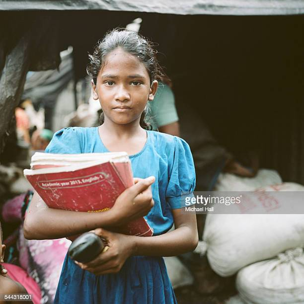 young girl from slum with school books - bangladeshi school girls stock photos and pictures
