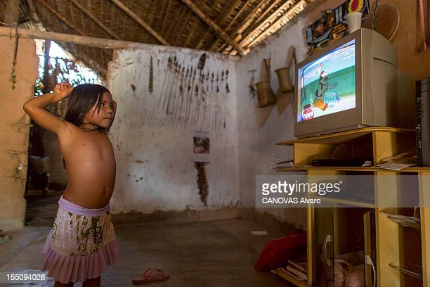 A young girl from the Guajajara Indians watches TV during May 2012 in the state of MaranhaoBrazil