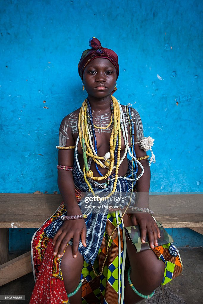 CONTENT] Young girl from the Krobo tribal group wear traditional beads. I photographed the dipo ceremony of the Krobo people. Africa many cultures celebrate the passage of a child towards adulthood. Among the hills Krobo of Ghana, young girls carry on an ancient tradition. Every year, girls undergo a transition to adulthood. In the beginning of the Dipo each woman Enters a house where they shed Their clothing representative of Their childhood and put on a new, mature set of clothing by Their ritual mother. Then, they shave Their Heads and wash in the river Which is meant to cleanse the body and spirit in preparation for womanhood. During this ceremony they dance to music to celebrate Their passage into wmoanhood, Represent and their Families by wearing handmade beads passed sown for generations, but most imnportantly to impress a suitor and the tribe's chief With Their new found grace and beauty.