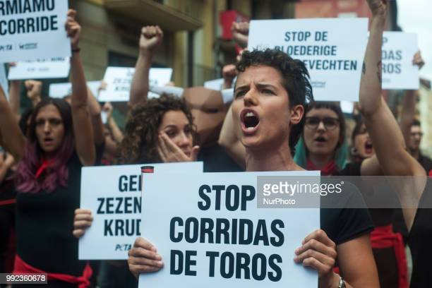 A young girl from the PETA collective shouts antibullfighting slogans during her protest in the Plaza del Ayuntamiento in Pamplona on the occasion of...
