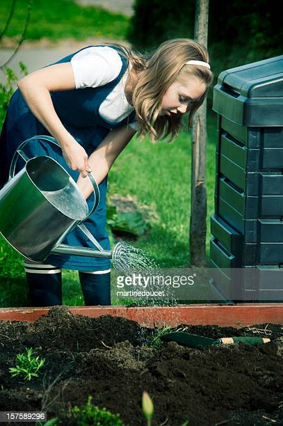 """young girl gardening. - """"martine doucet"""" or martinedoucet stock pictures, royalty-free photos & images"""