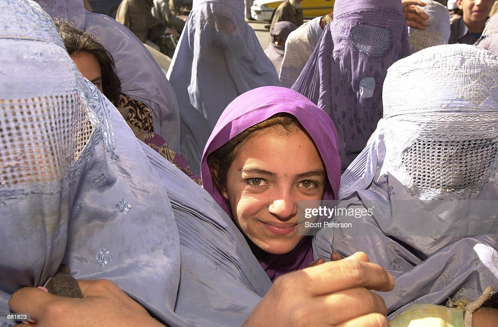 taliban prisoners of war pictures getty images a young girl gathers other afghan women in the streets to welcome the takeover of