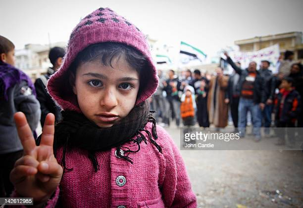 A young girl gestures during an antiAssad protest in the town of Binnish on April 9 2012 in Syria Conitnuing violence in northern Syria between...