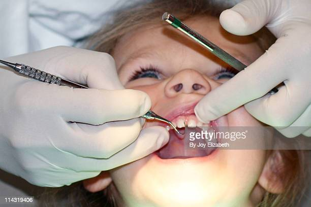 Young Girl Gets Dental Exam Cavitie