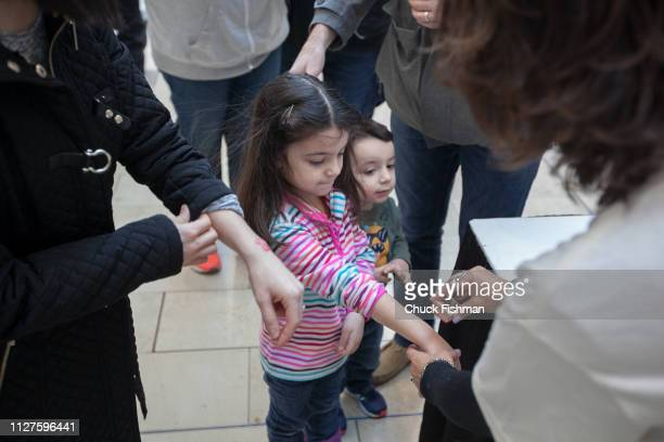 A young girl gets her arm stamped for entry to The Chocolate Expo at Garden State Plaza Mall Paramus New Jersey January 2019