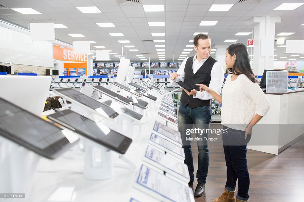 Young girl gets information about new products : Stock Photo