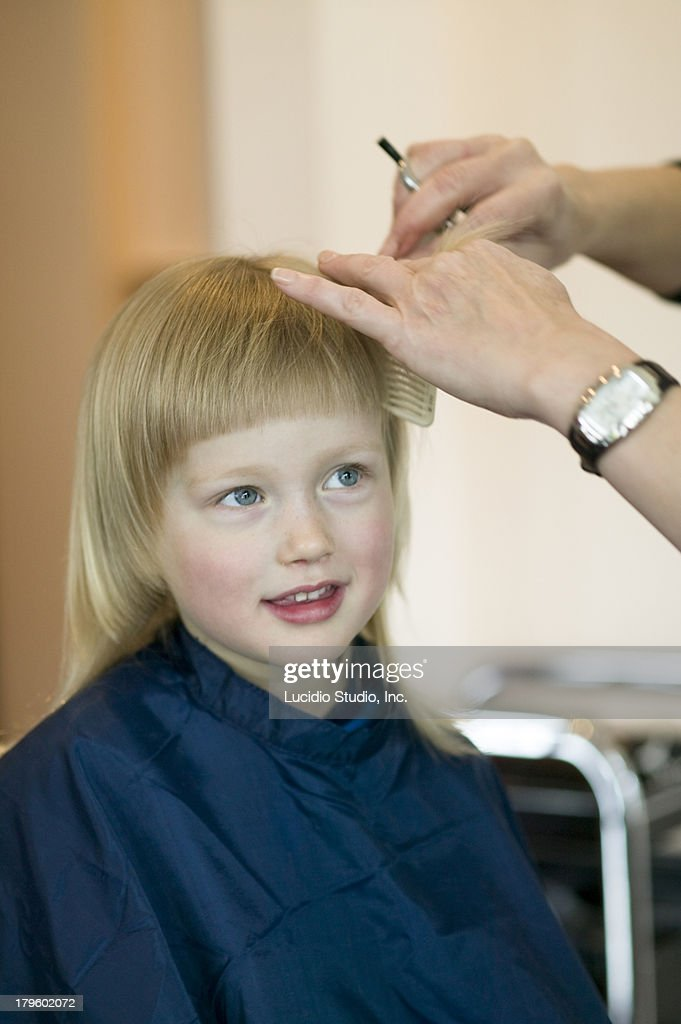 Young Girl Getting A Haircut Stock Photo Getty Images