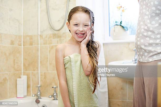 young girl getting dried after shower
