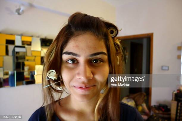 a young girl getting her hair fixed or stylish before a party event - färbemittel stock-fotos und bilder