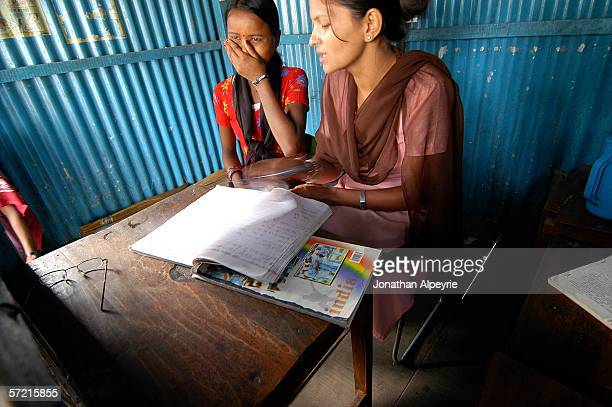 A young girl gives her personal information to a Maiti worker after being apprehended for illegally crossing the boarder into Kakarbhitta on October...