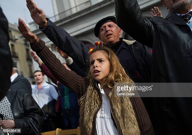 A young girl gives the fascist salute during the 39th anniversary of the death of Spanish dictator General Francisco Franco at Plaza Oriente square...