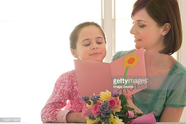 Young girl giving Mothering Sunday card
