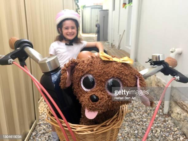 young girl going on a bike ride - rafael ben ari bildbanksfoton och bilder