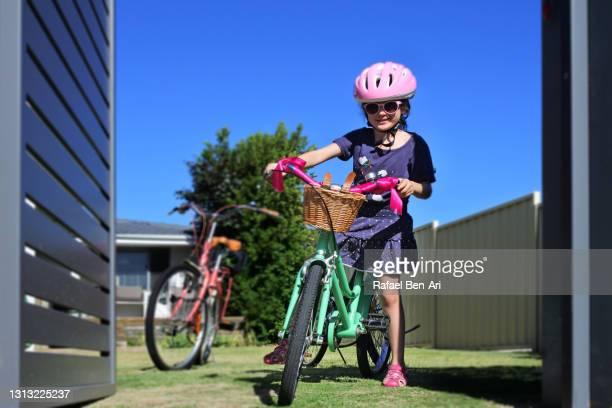 young girl going on a family bike ride - rafael ben ari stock-fotos und bilder