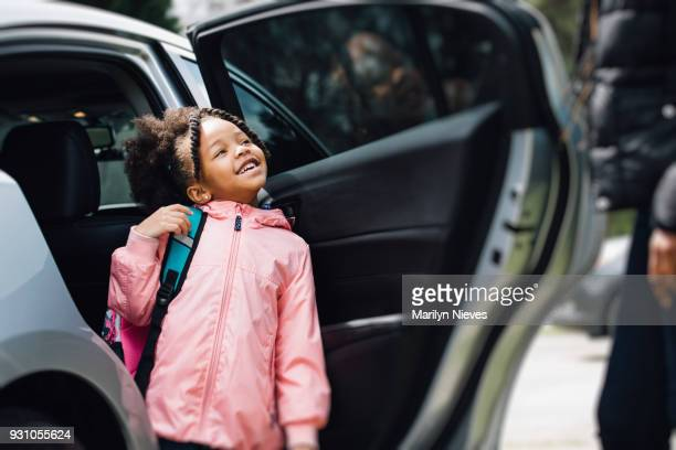 young girl going to school with parent - black jacket stock pictures, royalty-free photos & images