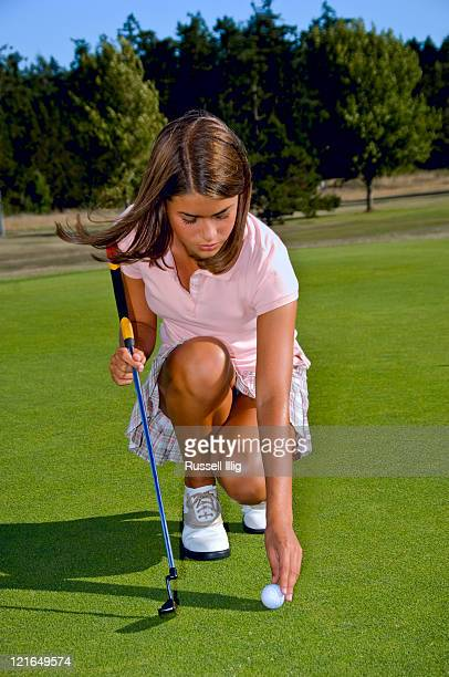 young girl golfer - teen mini skirt stock photos and pictures