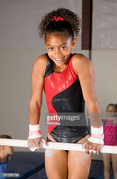 young girl gymnast - parallel bars gymnastics equipment stock photos and pictures