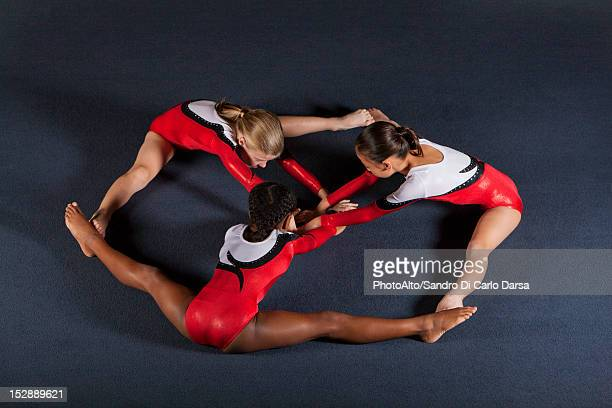 young girl gymnasts performing floor routine - floor gymnastics stock pictures, royalty-free photos & images