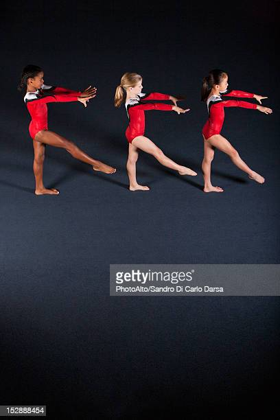 Young girl gymnasts practicing