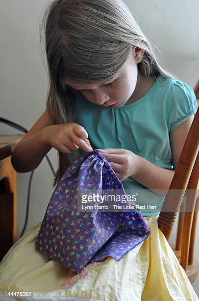 Young girl hand sewing