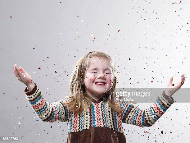 young girl hands up with confetti flying - flying solo after party bildbanksfoton och bilder