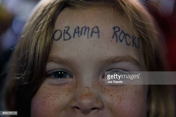 A young girl has Obama Rocks written on her forehead as Democratic presidential nominee US Sen Barack Obama speaks during a campaign rally at...