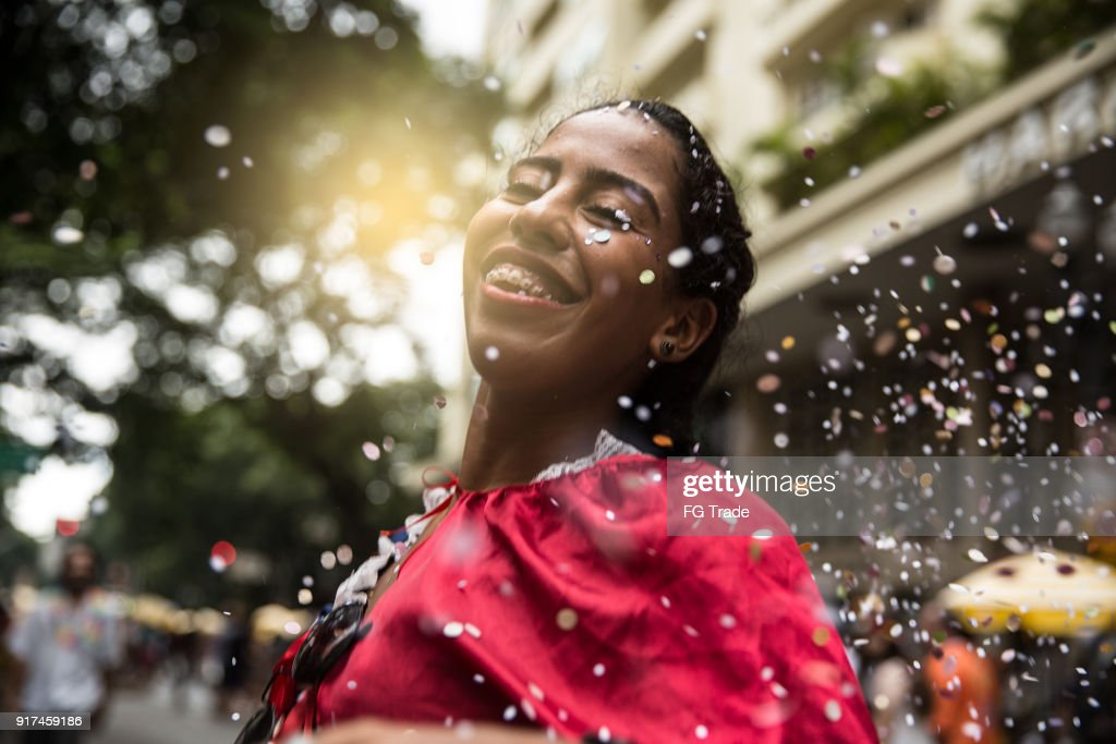 Young girl having fun at the carnival street : Stock Photo