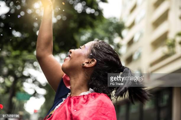 Young girl having fun at the carnival street