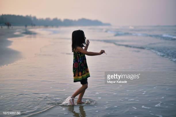 Young girl (4-5 years) having fun in the beach