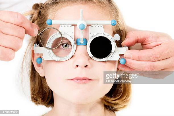 young girl having her eyesight checked. - myopia stock photos and pictures