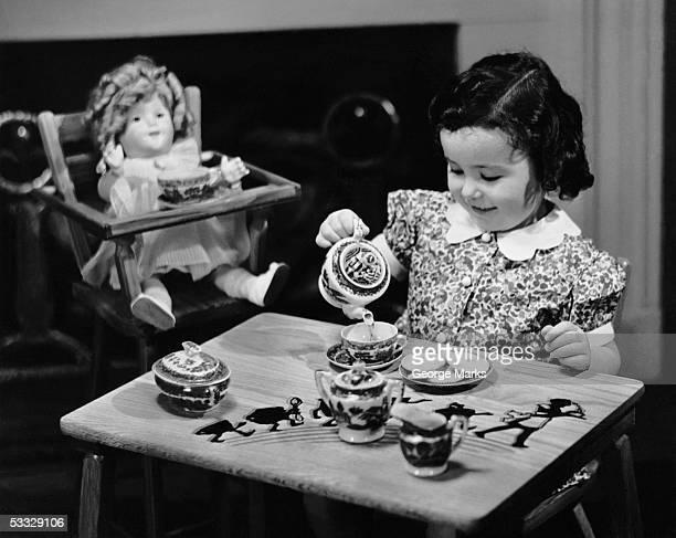 Young girl having tea party