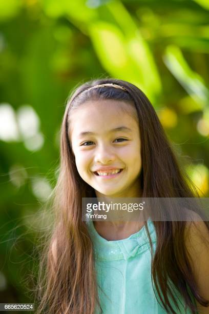 Young girl Hawaiian Polynesian Children in Tradition Clothing