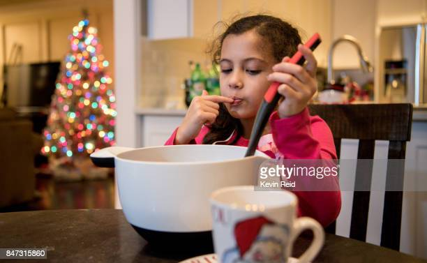 A young girl helps make desserts during the Holidays.