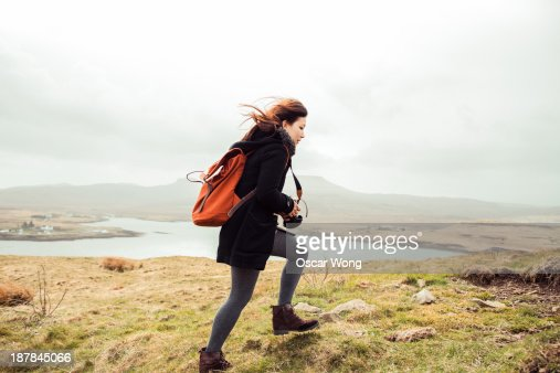 A young girl hiking alone in the wind
