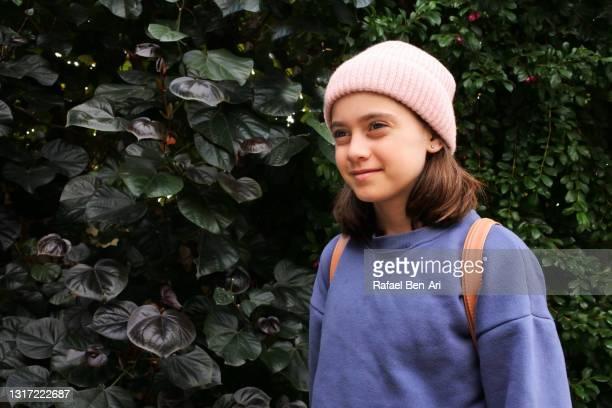 young girl hiking alone outdoors - rafael ben ari imagens e fotografias de stock