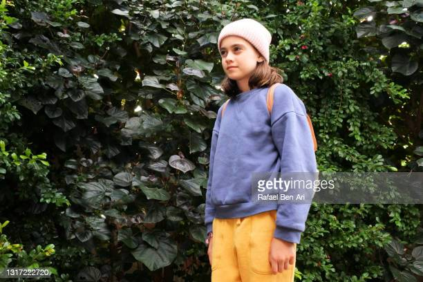 young girl hiking alone outdoors - rafael ben ari fotografías e imágenes de stock