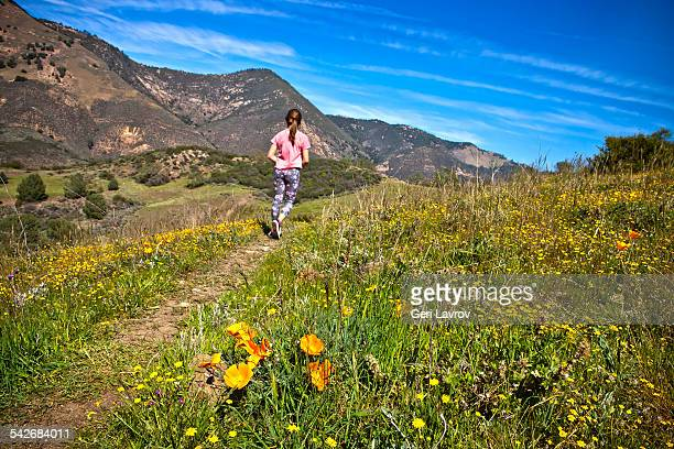Young girl hiking on a trail