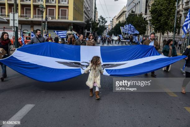 """Young girl hold a flag during a rally against the use of the term """"Macedonia"""" for the northern neighbouring country's name, at Athens. Greek..."""