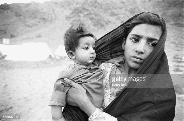 Young girl holding a baby in the refugee camp of Anoba